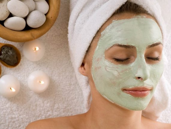 Cosmetician Applying Facial Mask To The Face Of Young Beautiful Woman In Spa Salon; Shutterstock ID 148466003; PO: aol; Job: production; Client: drone
